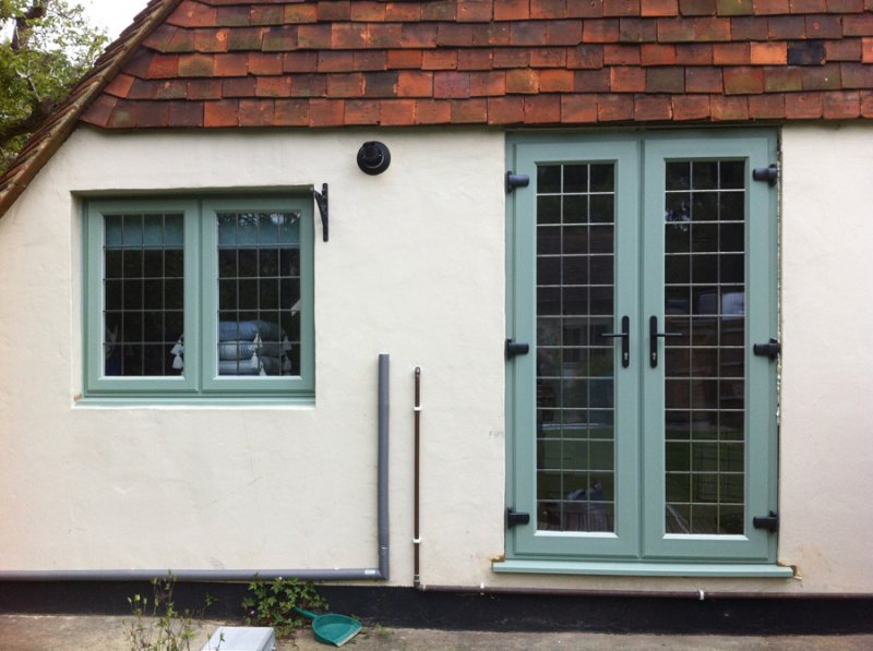 Green coloured windows doors and conservatories windows for Windows doors and conservatories