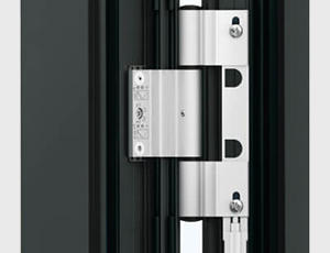 Close up of thick steel hinges on a black door